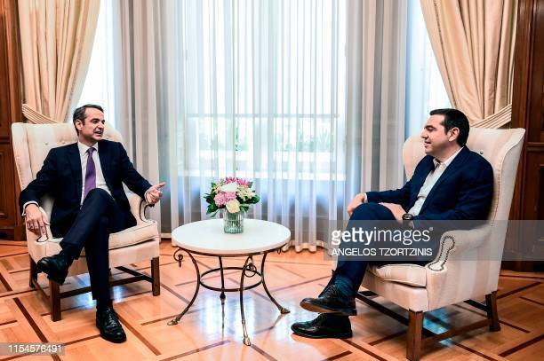 Newlyappointed Greek Prime Minister Kyriakos Mitsotakis meets with former Prime Minister Alexis Tsipras at the Maximos Mansion in Athens on July 8...