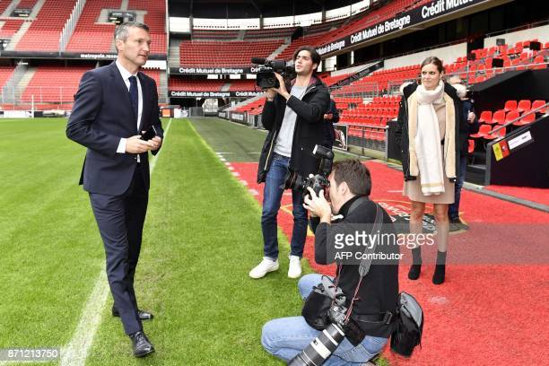 Newly-appointed President of the French L1 football club FC Rennes, Olivier Letang poses for photos within a press conference on November 7, 2017 at...