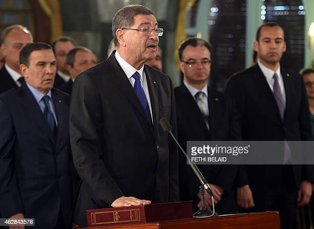 Newlyappointed Tunisian Prime minister Habib Essid takes an oath of office during the country's new government swearingin ceremony at Carthage Palace...