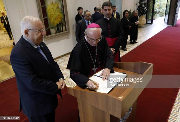 Newlyappointed Vatican Ambassador to Israel Papal Nuncio Archbishop Leopoldo Girelli signs the guest book after handing his diplomatic credentials to...