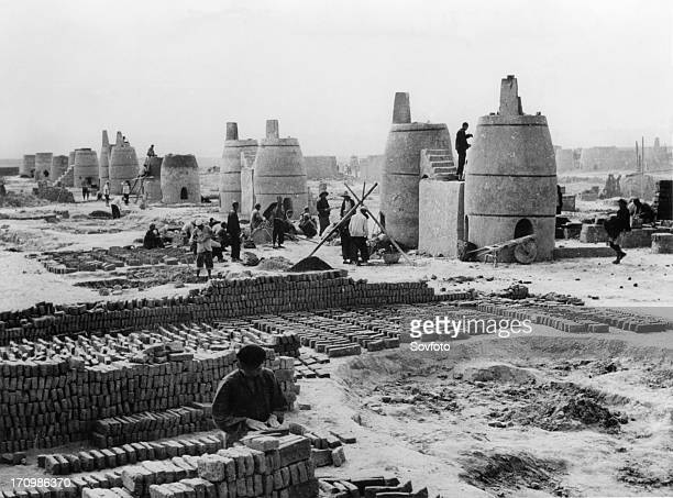 Newlybuilt small blast furnaces at yingshuichiao iron smelting works in chungwei county china great leap forward 1950s