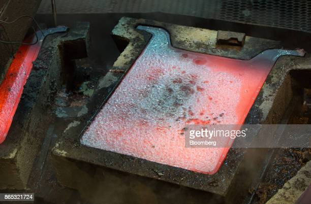 A newlycast copper anode sheet cools in its mold at the MMC Norilsk Nickel PJSC copper refinery in Norilsk Russia on Thursday Oct 19 2017 Norilsk...