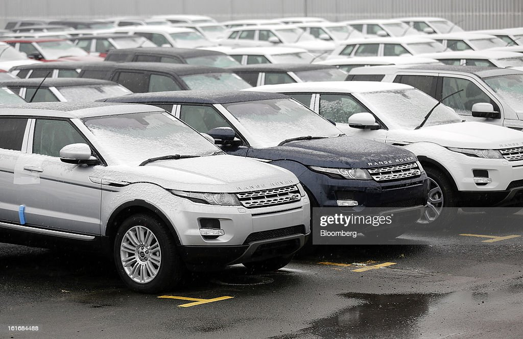 Newly-completed Range Rover Evoque SUV automobiles, produced by Jaguar Land Rover Plc, a unit of Tata Motors Ltd., stand in parking bays outside the company's assembly plant in Halewood, U.K., on Wednesday, Feb. 13, 2013. Carmakers from Ford Motor Co. to Audi AG and Jaguar Land Rover Plc are using record amounts of aluminium to replace heavier steel, providing relief to producers of the metal confronting excess supplies and depressed prices. Photographer: Simon Dawson/Bloomberg via Getty Images