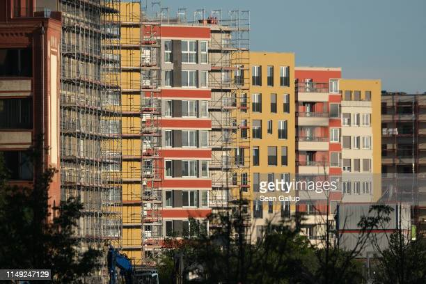 Newlyconstructed apartment buildings stand in the city center on May 14 2019 in Berlin Germany Real estate prices in the German capital have risen...