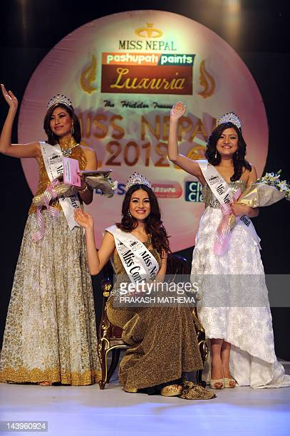 Newlycrowned Miss Nepal Shristi Shrestha first runner up Nagma Shrestha and second runner up Subeksha Khadka wave in greeting following the contest...