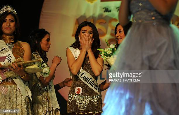 Newlycrowned Miss Nepal Shristi Shrestha gestures after wiining the contest in Kathmandu on May 06 2012 Miss Nepal Shristi Shrestha will go on to...