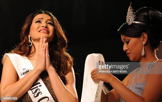 Newlycrowned Miss Nepal Shristi Shrestha gestures while she get crowned following the contest in Kathmandu on May 06 2012 Miss Nepal Shristi Shrestha...