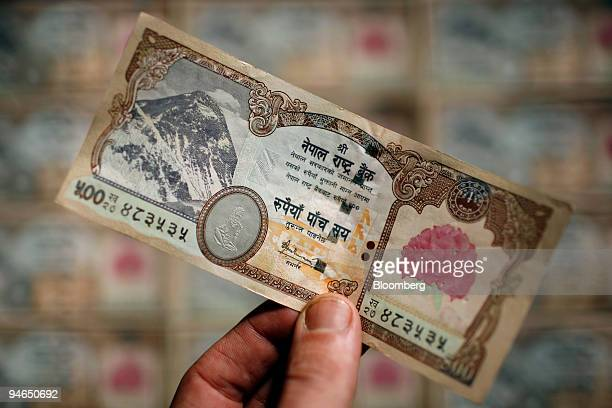 Newly-designed Nepalese 500 Rupee note, without the image of Nepal's King Gyanendra, is displayed for a photograph in Kathmandu, Nepal, on Saturday,...