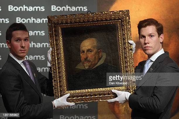 Newly-discovered painting by Spanish artist Diego Rodriguez de Silva y Velazquez is held up for display as it goes under the hammer at the Old Master...
