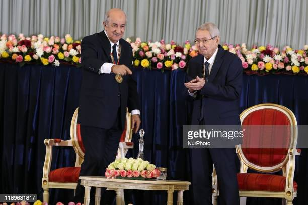 Newlyelected Algerian President Abdelmadjid Tebboune and interim president Abdelkader Bensalah attend Tebbounes swearingin ceremony Algiers Algeria...
