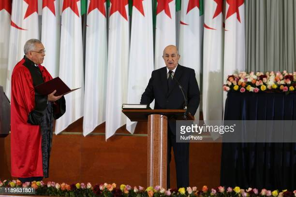 Newlyelected Algerian President Abdelmadjid Tebboune takes the oath of office during the swearingin ceremony in Algiers Algeria 19 December 2019...