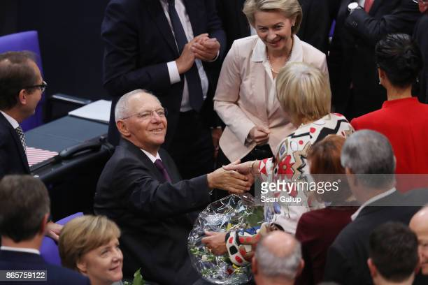 Newlyelected Bundestag President Wolfgang Schaeuble receives the congratulations of parliamentarians shortly after he was elected at the opening...
