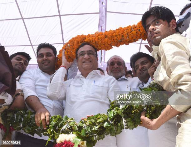 Newlyelected Delhi Youth Congress President Vikas Chhikara and DPCC president Ajay Maken being garlanded during an oathtaking ceremony at the DPCC...