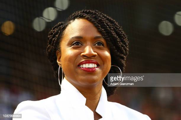 Newlyelected Democratic Congresswoman Ayanna Pressley looks on before a game between the Boston Red Sox and the Houston Astrosat Fenway Park on...