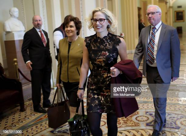 Newlyelected Democratic senatorselect Kyrsten Sinema and Jacky Rosen walk to the office of Senate Minority Leader Chuck Schumer for a meeting at the...