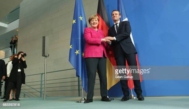 Newlyelected French President Emmanuel Macron and German Chancellor Angela Merkel depart after speaking to the media following talks at the...