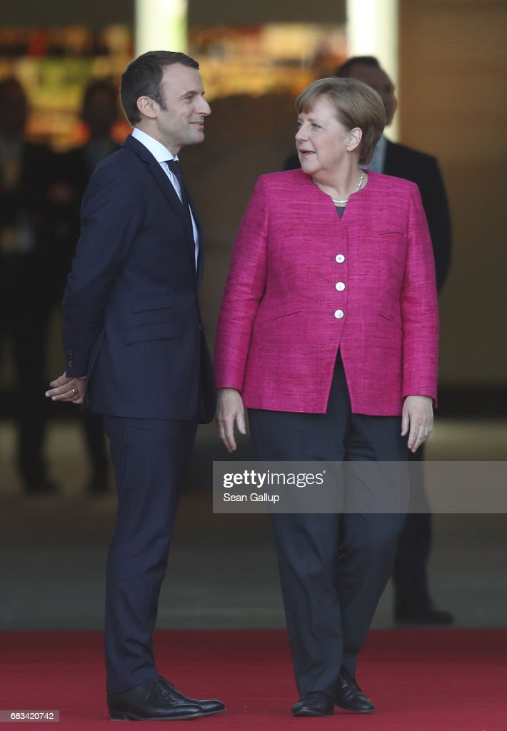 Newly-elected French President Emmanuel Macron and German Chancellor Angela Merkel chat upon Macron's arrival at the Chancellery on May 15, 2017 in Berlin, Germany. Macron is visiting Berlin only a day after being sworn in as president in Paris. While Macron and Merkel have both demonstrated an unwavering commitment to the European Union and Merkel strongly applauded Macron's election, they are likely to differ over Macron's desire for E.U.-issued bonds, a measure Merkel has strongly opposed in the past.