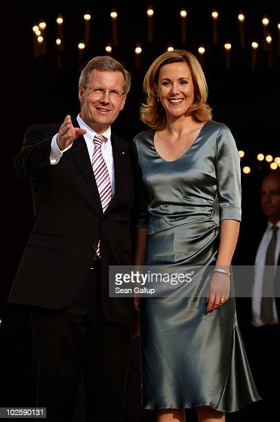 Newlyelected German President Christian Wulff and his wife First Lady Bettina Wulff attend the President's annual summer garden party at Schloss...