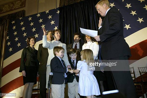 WASHINGTON DC Newlyelected House Minority Leader Nancy Pelosi surrounded by her children and grandchildren is sworn in by Rep Dick Gephardt Tuesday...