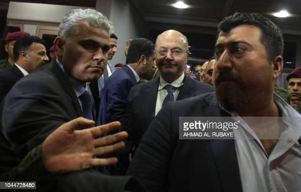 Newlyelected Iraqi President Barham Saleh walks out of the Parliament in Baghdad on October 2 2018