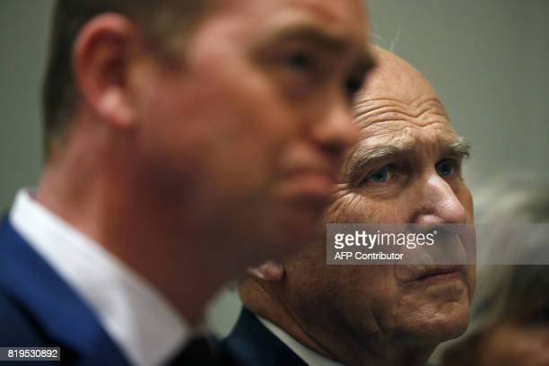 Newlyelected leader of the Liberal Democrats Sir Vince Cable sits beside former party leader Tim Farron during a press conference to announce the new...