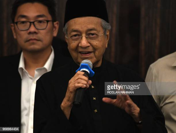 Newlyelected Malaysian Prime Minister and opposition candidate Mahathir Mohamad speaks during a press conference in Kuala Lumpur on May 10 2018...