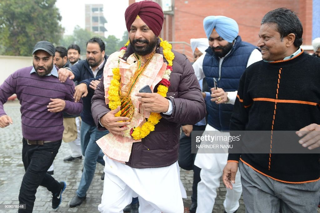 Newlyelected Mayor of Amritsar Karamjit Singh Rintu walks along with his supporters in Amritsar on January 23 2018 Congress leader Karamjit Singh...