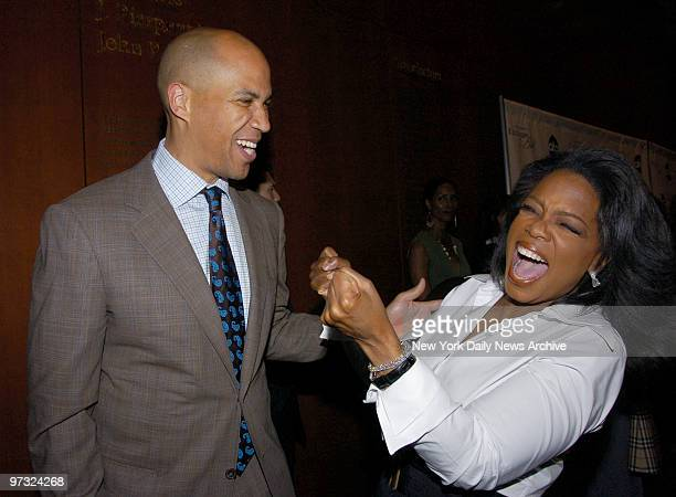 Newlyelected Newark Mayor Cory Booker and Oprah Winfrey arrive at the Morgan Library Museum for a screening of her upcoming TV special Oprah...