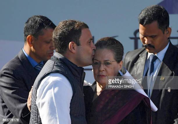 Newlyelected President of the Indian National Congress party Rahul Gandhi kisses his mother and former party President Sonia Gandhi during a ceremony...