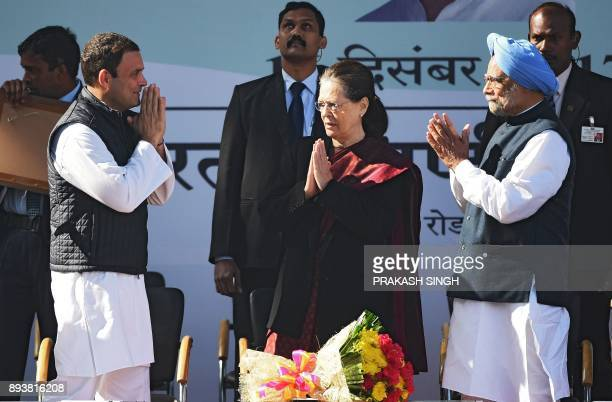 Newlyelected President of the Indian National Congress party Rahul Gandhi gestures to greet his mother and former party President Sonia Gandhi and...