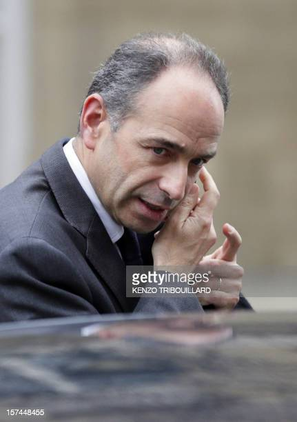 Newlyelected President of the rightwing UMP opposition party JeanFrancois Cope speaks on his mobile after a meeting with former Prime Minister...