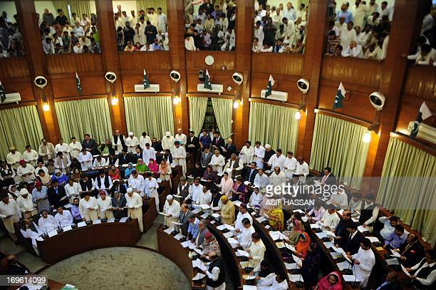 Newlyelected Sindh provincial assembly members take oath an at the main hall of the Sindh provincial assembly building in Karachi on May 29 2013 The...