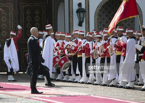 Newly-elected Tunisian President Kais Saied inspects the honour guards as he is welcomed with a military ceremony at the Palace of Carthage in Tunis,...