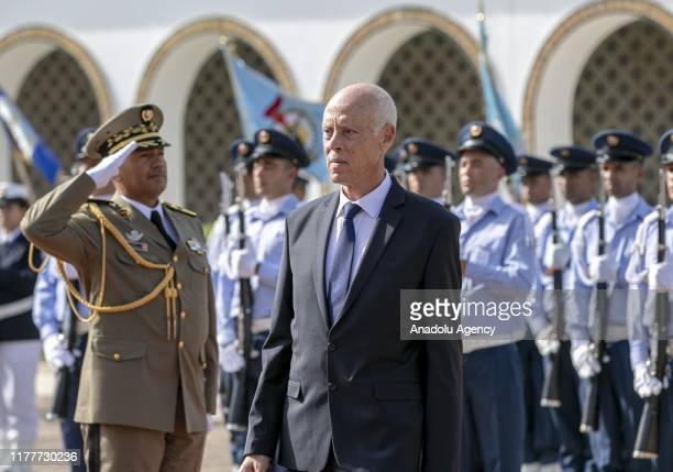 Newly-elected Tunisian President Kais Saied walks past the honour guards as he is welcomed with a military ceremony at the Palace of Carthage in...