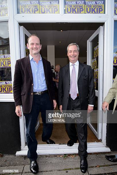 Newlyelected UK Independence Party MP Douglas Carswell and party leader Nigel Farage pose for pictures outside the party's local office in...