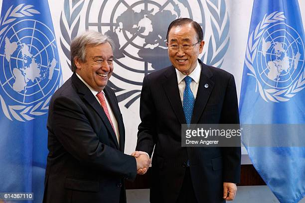 Newlyelected United Nations Secretary Generaldesignate Antonio Guterres and outgoing secretary general Ban Kimoon shake hands during a photo...