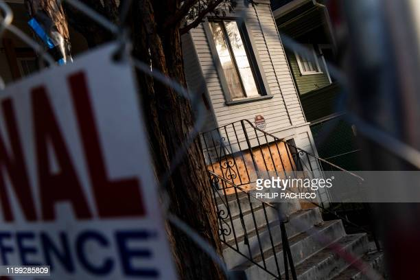 Newly-erected fence blocks the front of a vacant home that Moms 4 Housing activists occupied during a months-long protest which ended in a court...