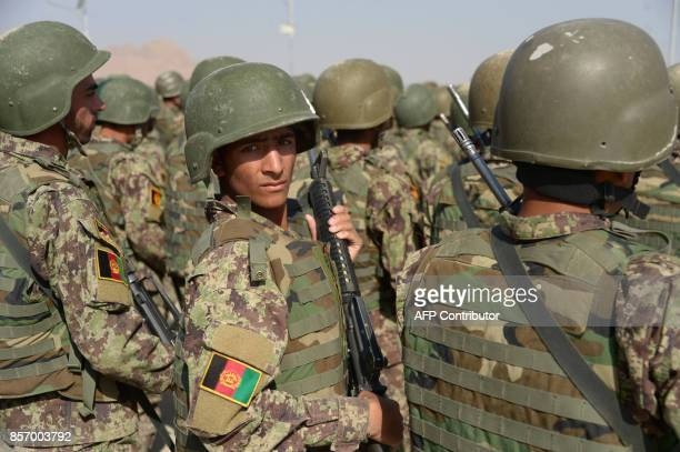 Newlygraduated Afghan National Army cadets march during a graduation ceremony at the ANA training centre in Herat province on October 3 2017 Around...
