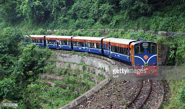 A newlyintroduced 'Himalayan Princess' toy train makes its way through the Darjeeling hills in celebration of the 127th birthday of the Darjeeling...