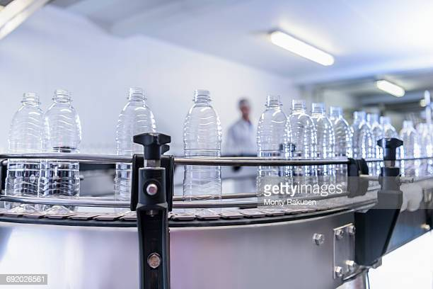 Newly-manufactured plastic bottles on production line in spring water factory