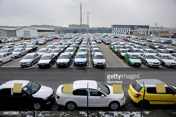 Newlymanufactured Skoda and Seat automobiles stand in a parking lot before distribution at the Skoda Autos AS plant in Mlada Boleslav Czech Republic...