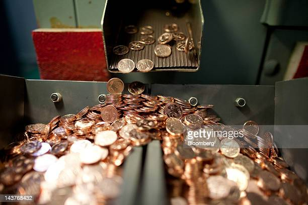 Newlyminted 2 cent euro coins fall into a container during manufacture at the Bank of Greece's Printing Works Department and Mint in Athens Greece on...
