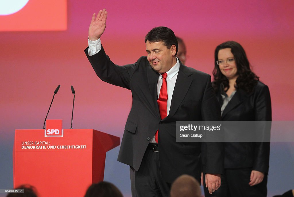Newly-reelected leaders of the German Social Democrats (SPD) General Secretary Andrea Nahles and Chairman Sigmar Gabriel arrive for a group photo shortly after their reelection on the second day of the SPD annual federal congress on December 5, 2011 in Berlin, Germany. The SPD is Germany's biggest opposition party and has seen its popularity rise in the last year as the current German government coalition of Christian Democrats and Free Democrats has faced political stumbling blocks.