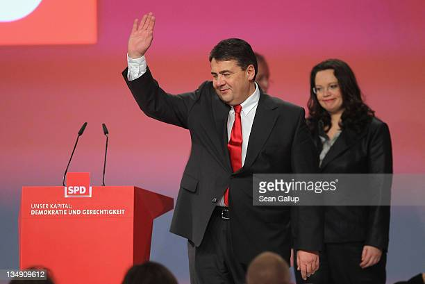 Newlyreelected leaders of the German Social Democrats General Secretary Andrea Nahles and Chairman Sigmar Gabriel arrive for a group photo shortly...