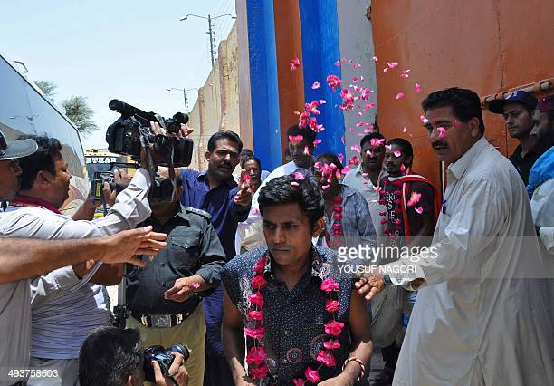Newlyreleased Indian fishermen are showered with rose petals as they leave a Pakistani prison in Hyderabad on May 25 2014 Some 151 Indian fishermen...