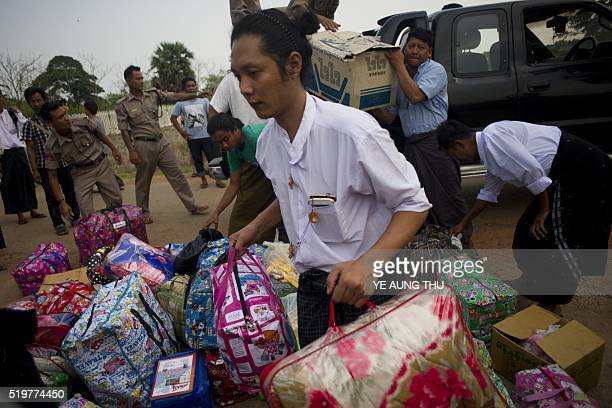 Newly-released political student protester carries his bags after his release in Tharrawaddy town, Bago Region in Myanmar on April 8, 2016. A Myanmar...