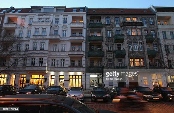 A newlyrenovated apartment building and one in a dilapidated state stand in Rykestrasse in Prenzlauer Berg district on January 17 2011 in Berlin...