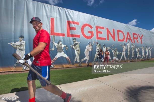 Newlysigned Boston Red Sox player JD Martinez heads for the batting cage for the first time during spring training at JetBlue Park in Fort Myers FL...