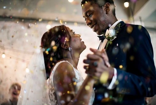 Newlywed african descent couple dancing wedding celebration 690830614