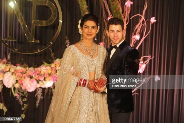 Newlywed Bollywood actor Priyanka Chopra and American singer Nick Jonas pose for photos during their wedding reception at Taj Palace on December 4...